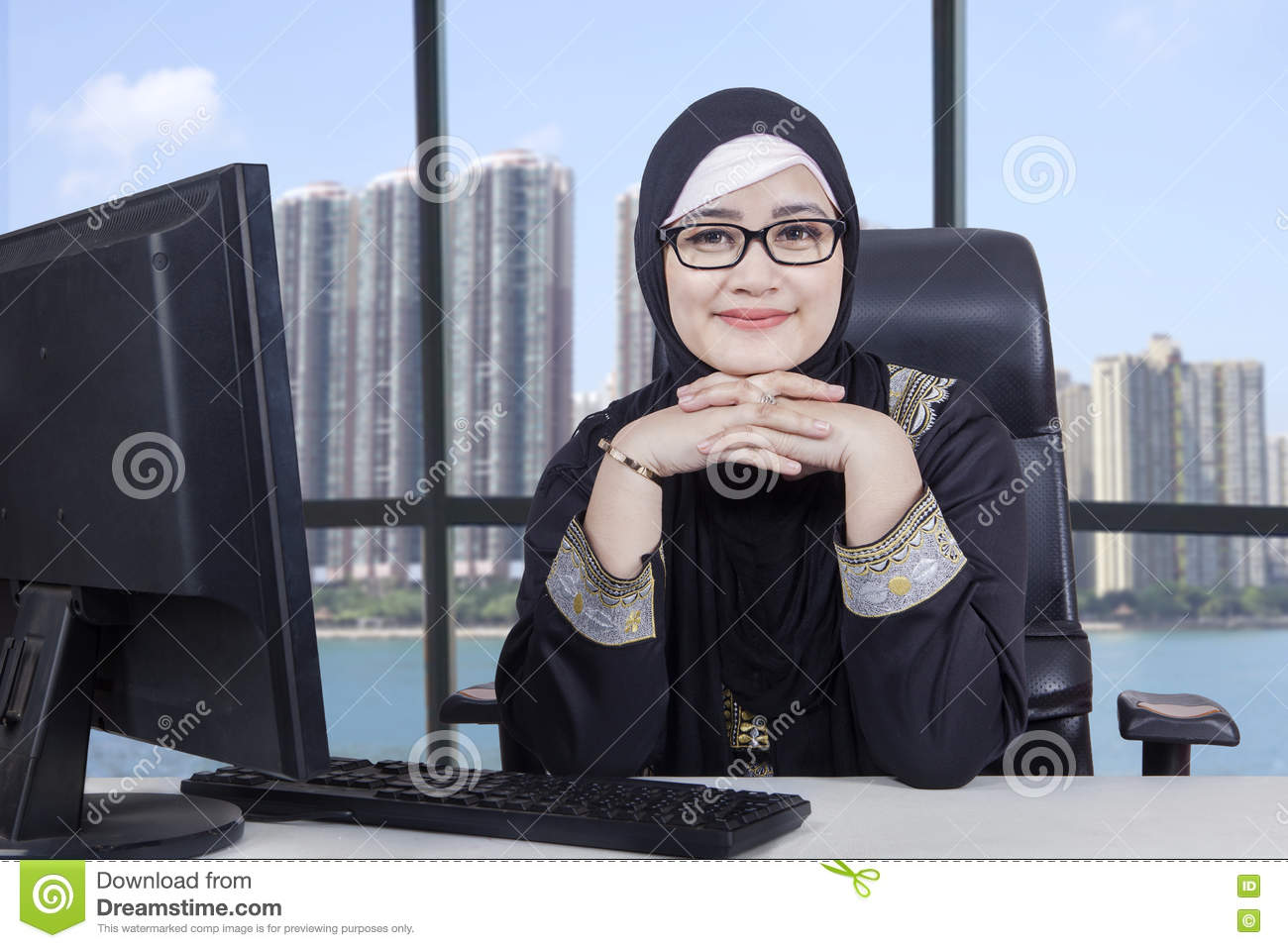 Arabic female worker with computer in office