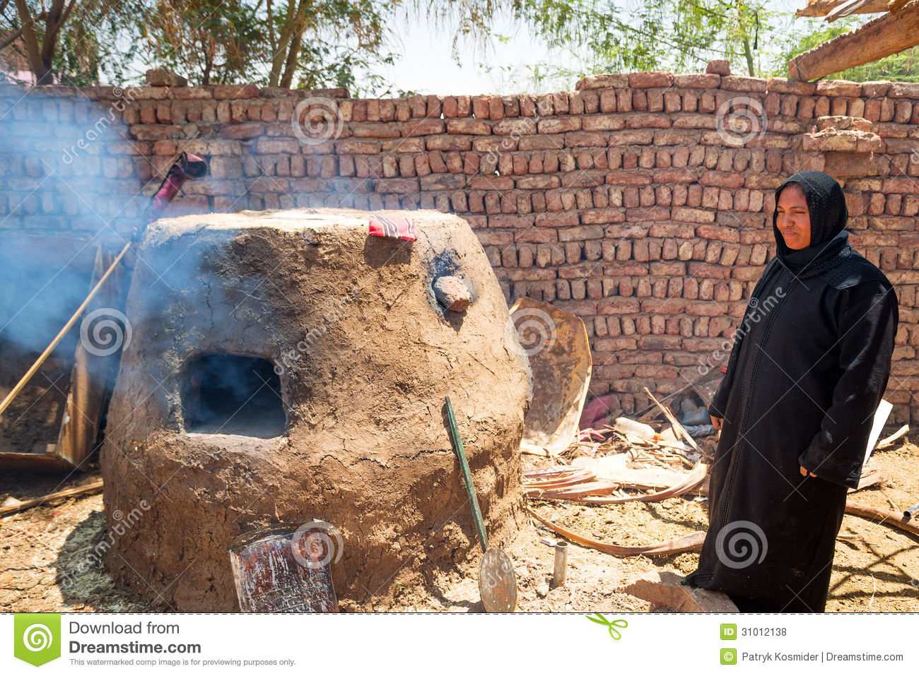 Arabic Woman Baking Bread In The Bedouin Village Editorial