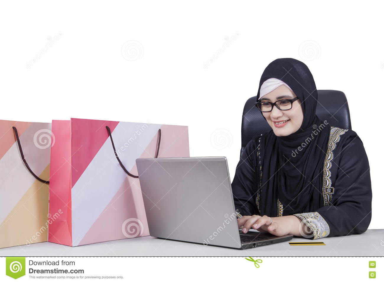 Arabic woman using laptop for shopping online