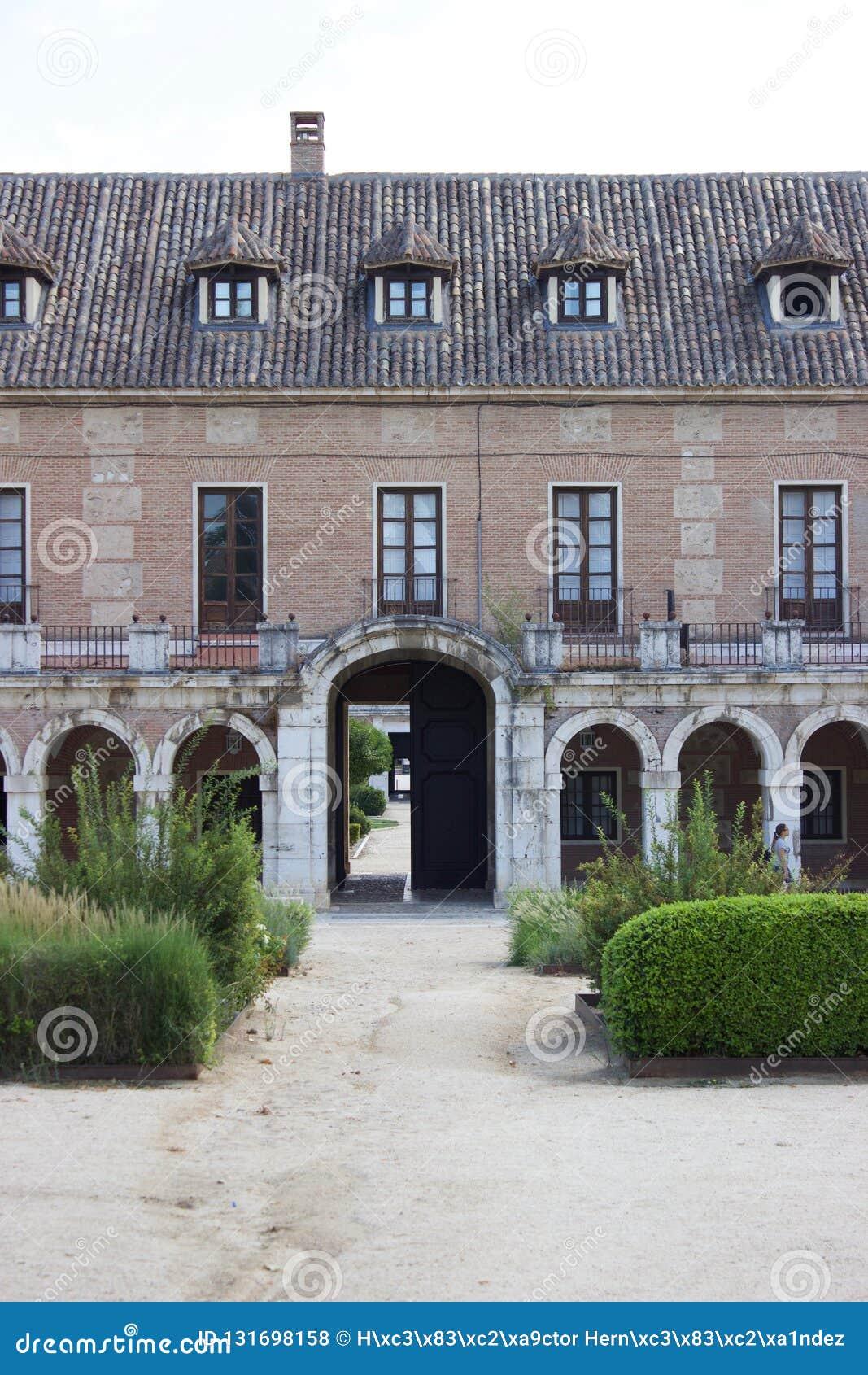 Aranjuez, Spain; November 12, 2018: Royal palace side facade acess gate and garden