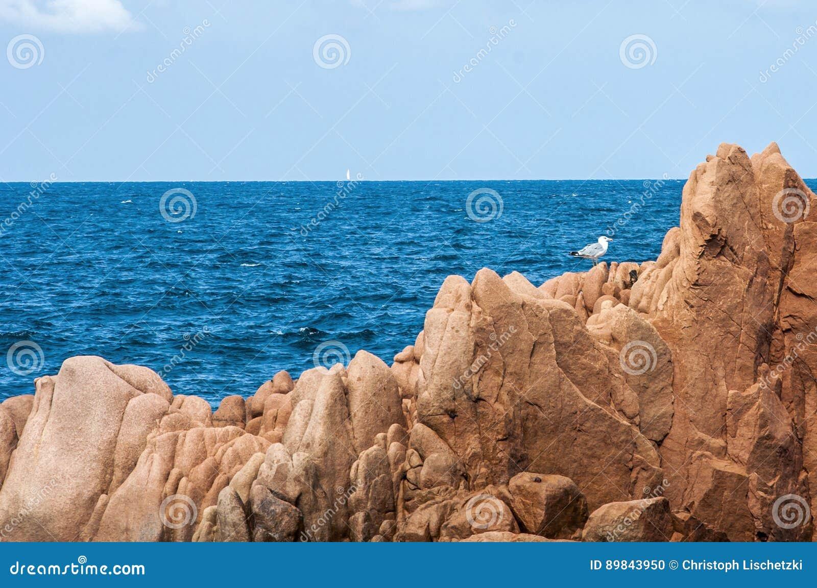 Arbatax red porphyry rocks nearby port Capo Bellavista sardegna Sardinia Italy Europe