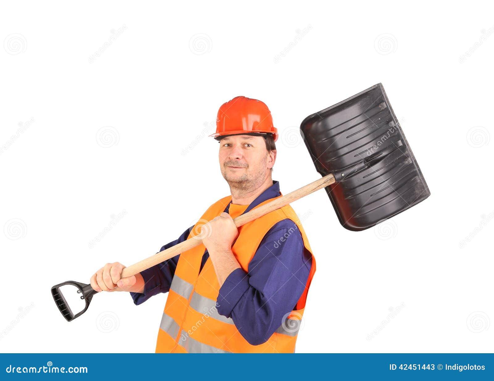 Arbeitskraft im Schutzhelm, der Schaufel hält