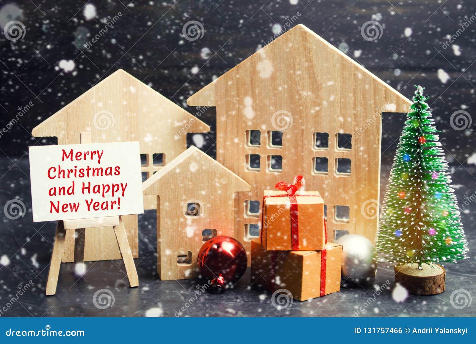 Arbre de Noël, maisons en bois et cadeaux avec l inscription