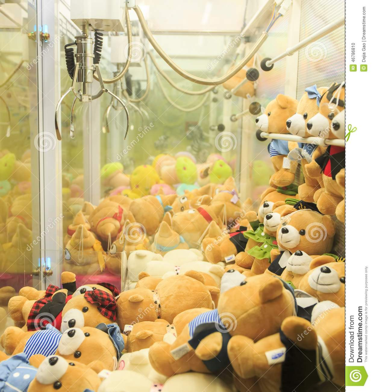Toy Claw Machine Game : Arcade claw machine toys crane game editorial image