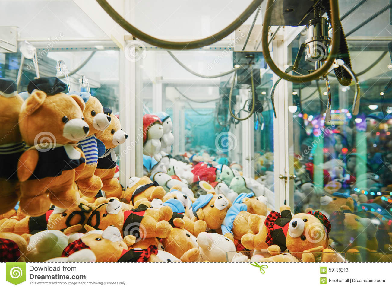 Claw Machine Plush Toys : Arcade robotic claw game machine stock photo image