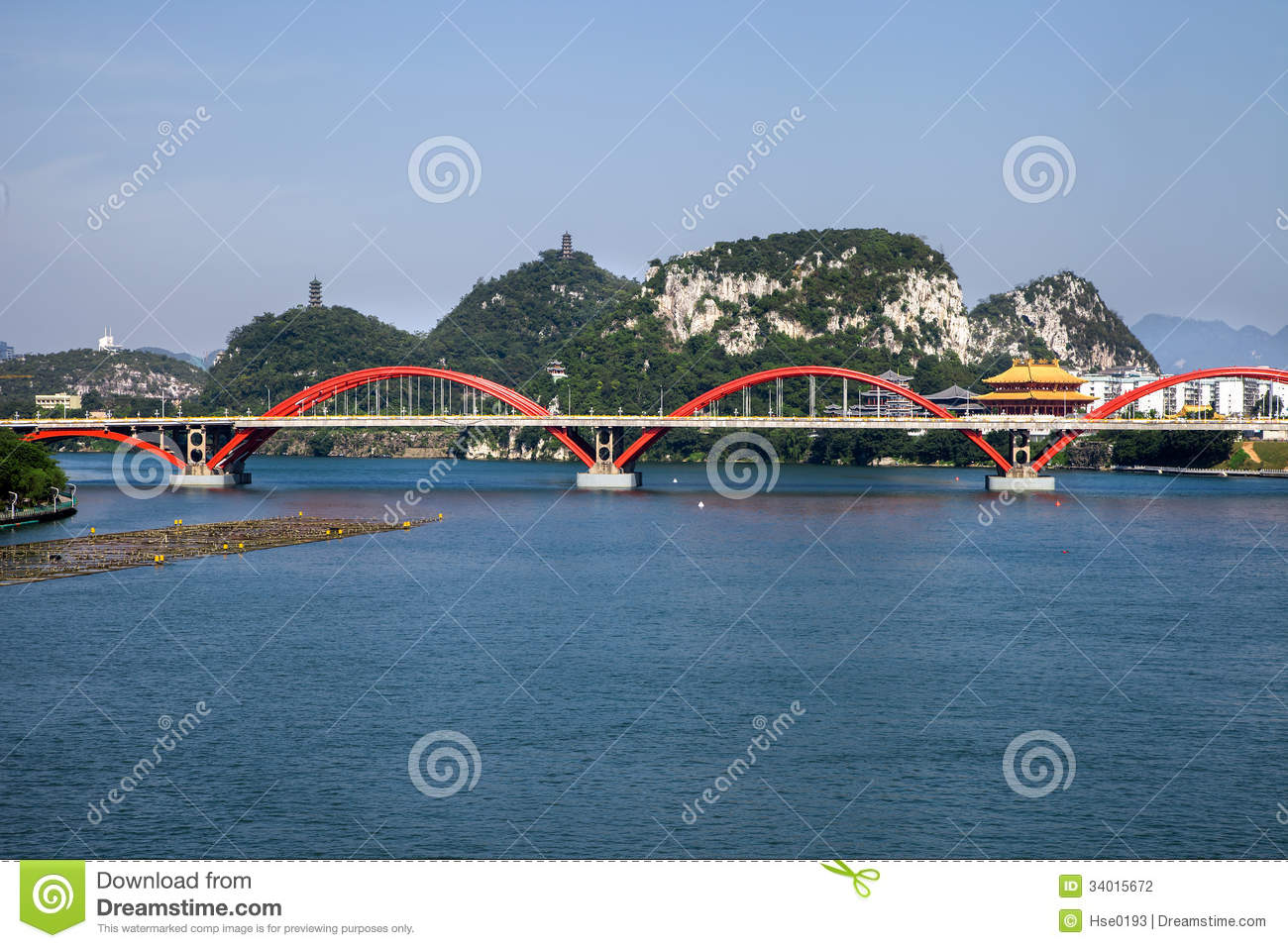 Arch bridge on river with natural landscape,Liuzhou,China