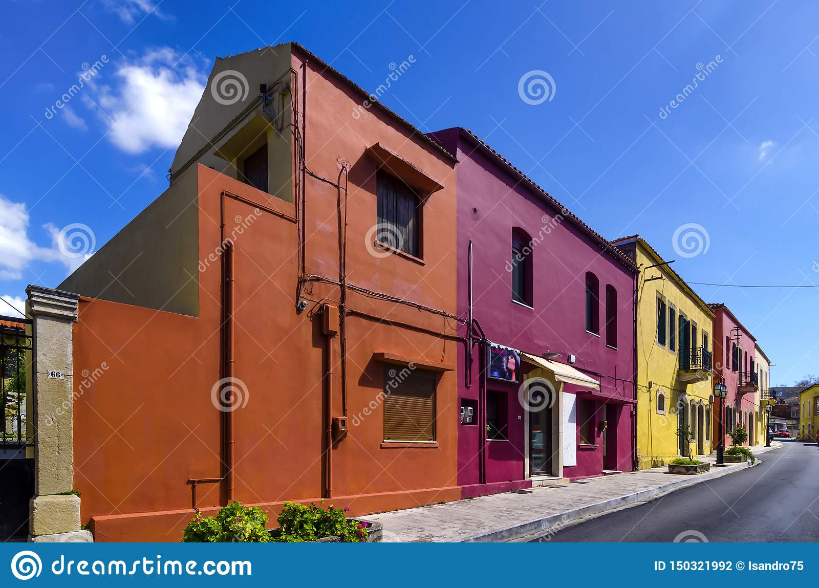 Colorful old traditional houses in Archanes town under the bright sun