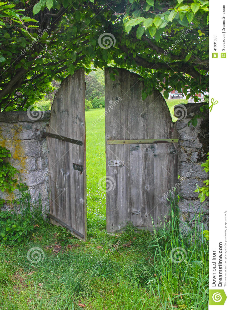 Arched Garden Door Framed With Beech Hedge Stock Photo