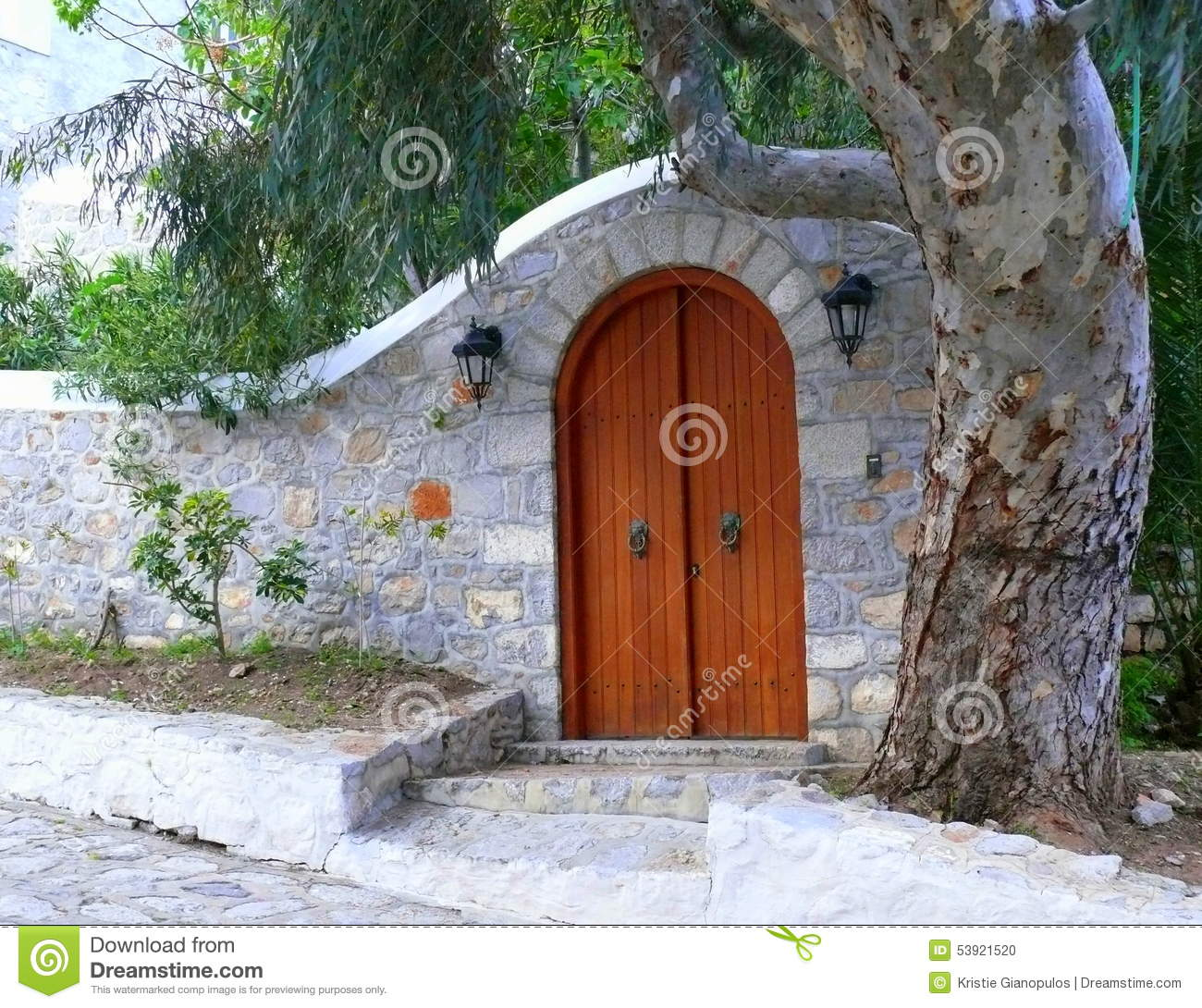 Stock Photo Arched Stone Courtyard Entry Wall Arched Wooden Door Masonry Paneled Wood Lantern Lights Old Mature Sycamore Tree Image53921520 on Small House Plans With Courtyard