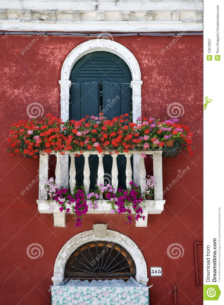 Arched window with balcony and flowers stock image - image: .