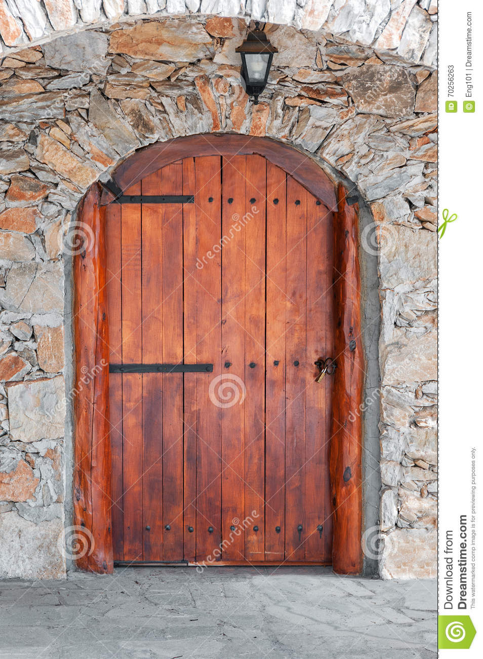 Arched wooden door in a stone wall stock photo image for Door of stone