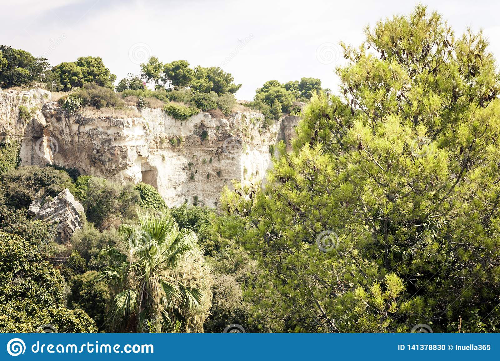 Archeological park, rocks near Greek Theatre of Syracuse, ruins of ancient monument, Sicily, Italy