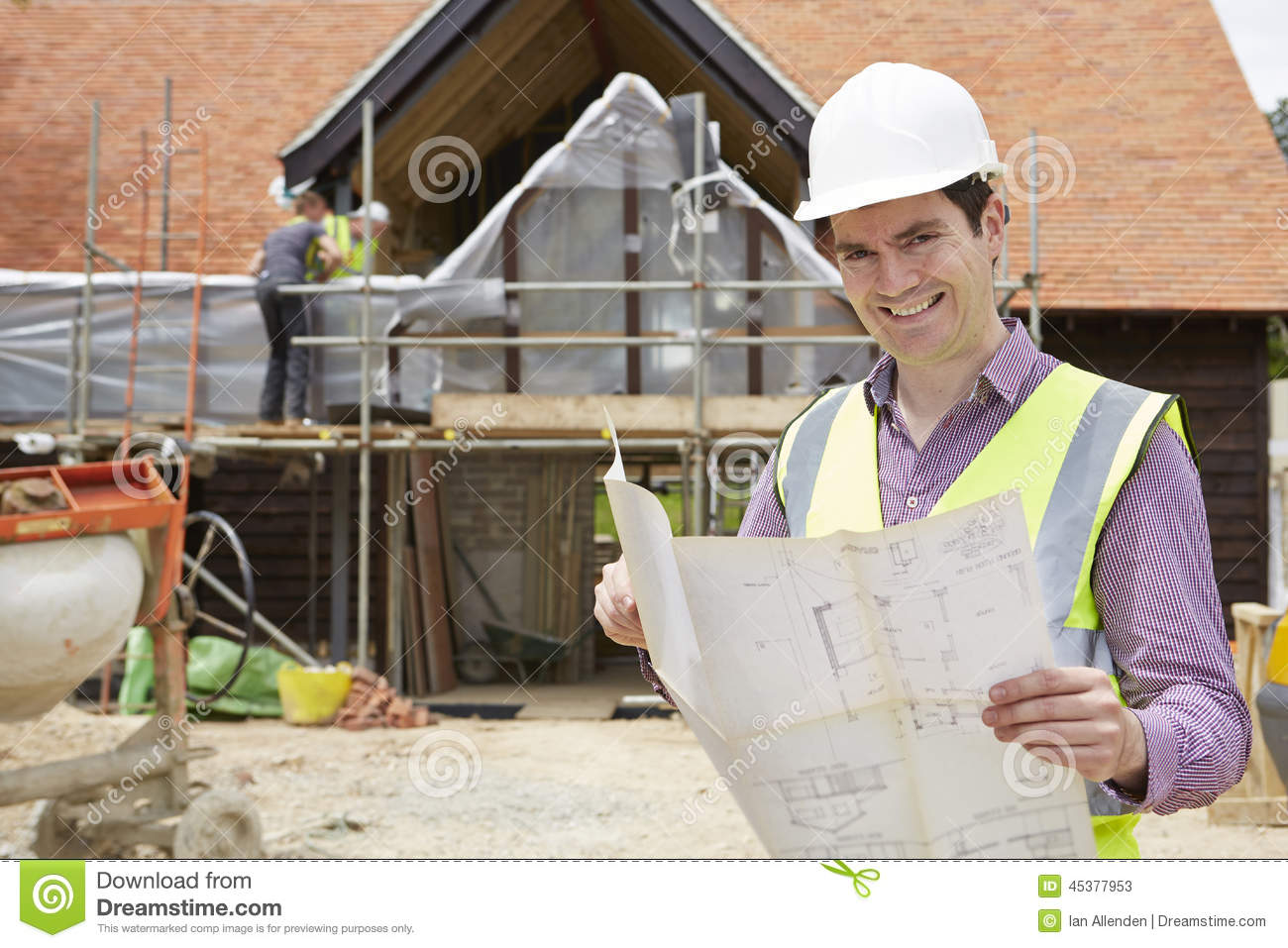 rchitect On Building Site Looking t House Plans Stock Photo ... - ^