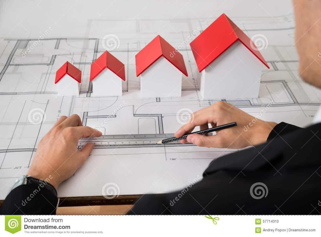 Architect with different size house models on blueprint stock photo download architect with different size house models on blueprint stock photo image of designer malvernweather Choice Image