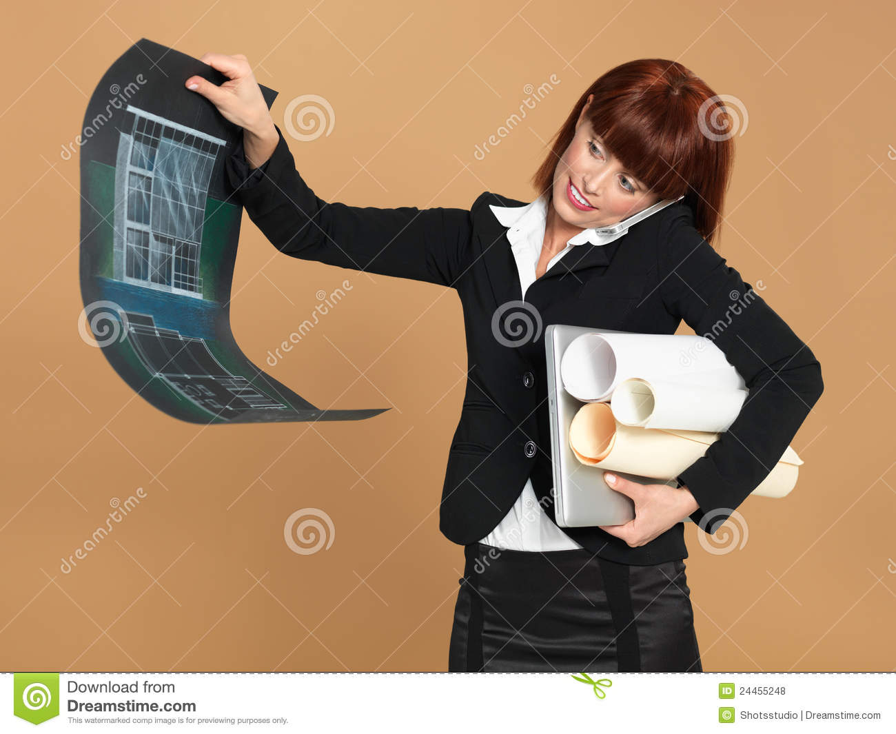 Architect holding laptop, papers,
