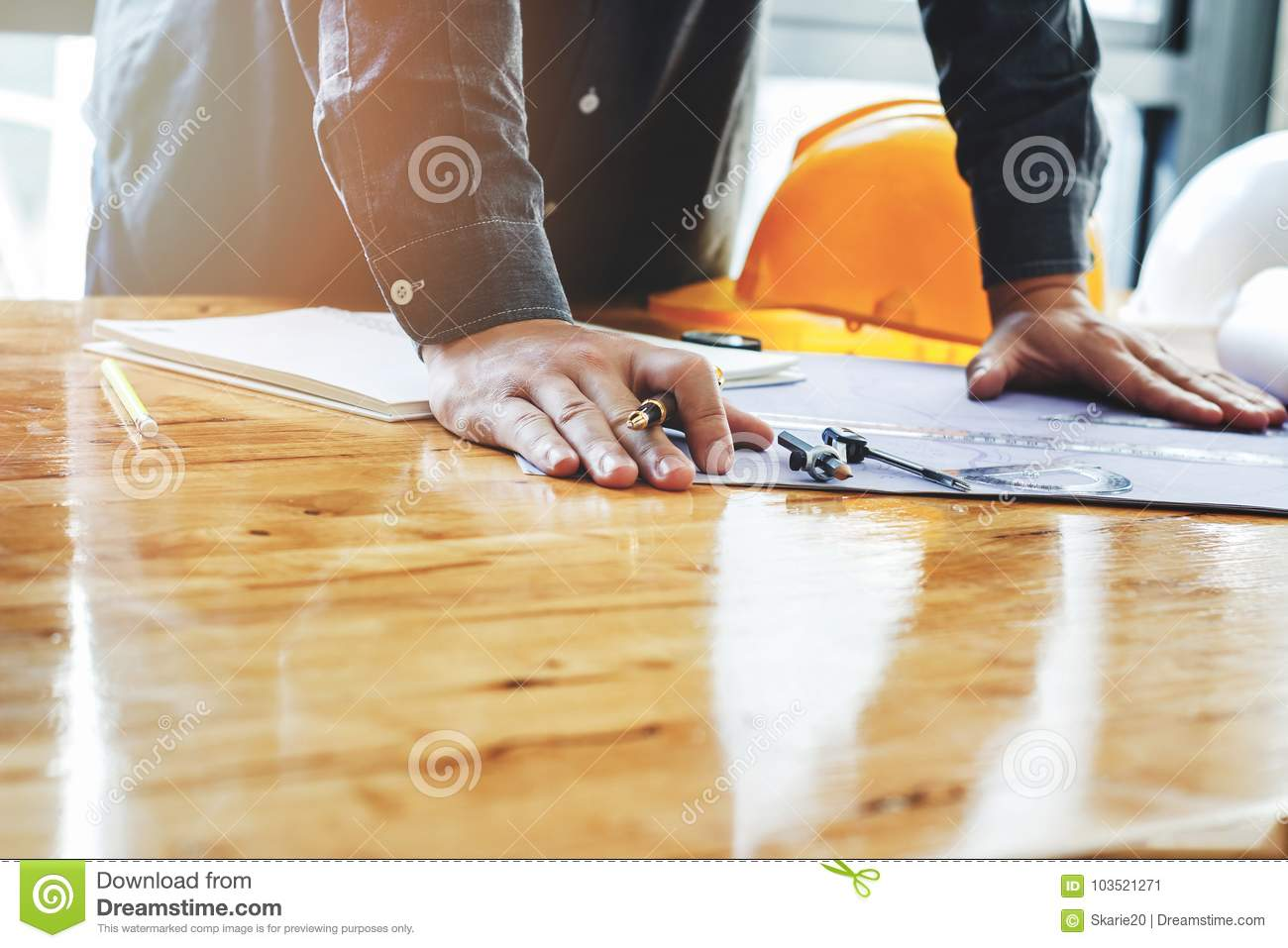 Architect holding a pen on project blueprint stock image image of royalty free stock photo malvernweather Gallery