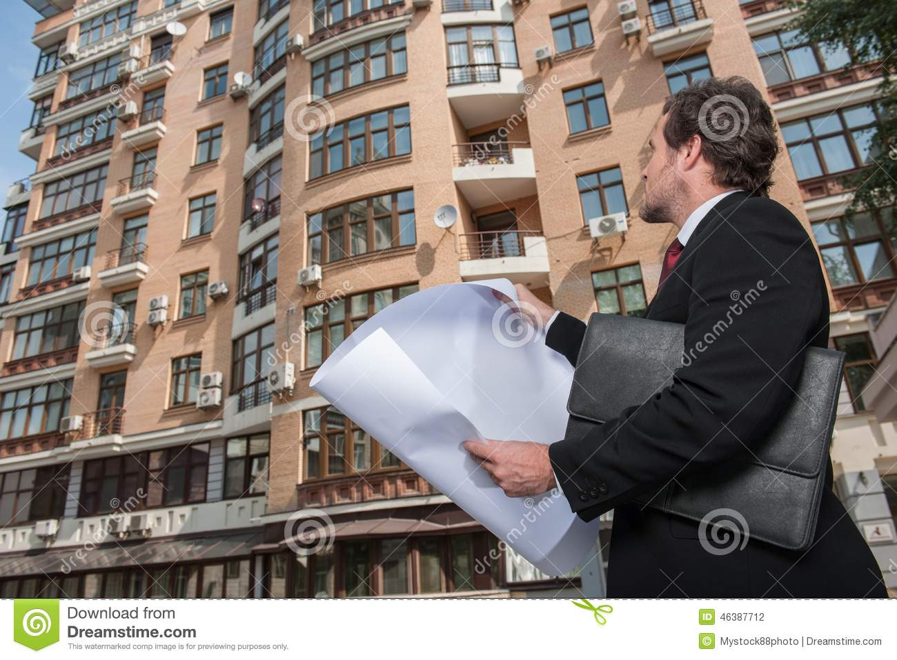 Architect surveying a new building plot royalty free stock for Looking for an architect to design a house