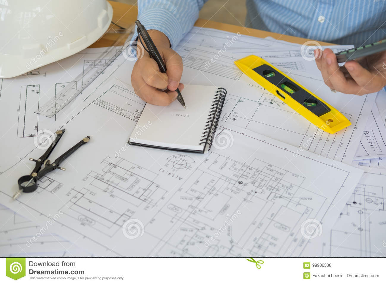 Architect or planner working on drawings for construction plans