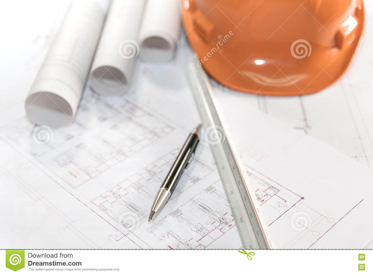 Architect plans project drawing and pen with blueprints rolls