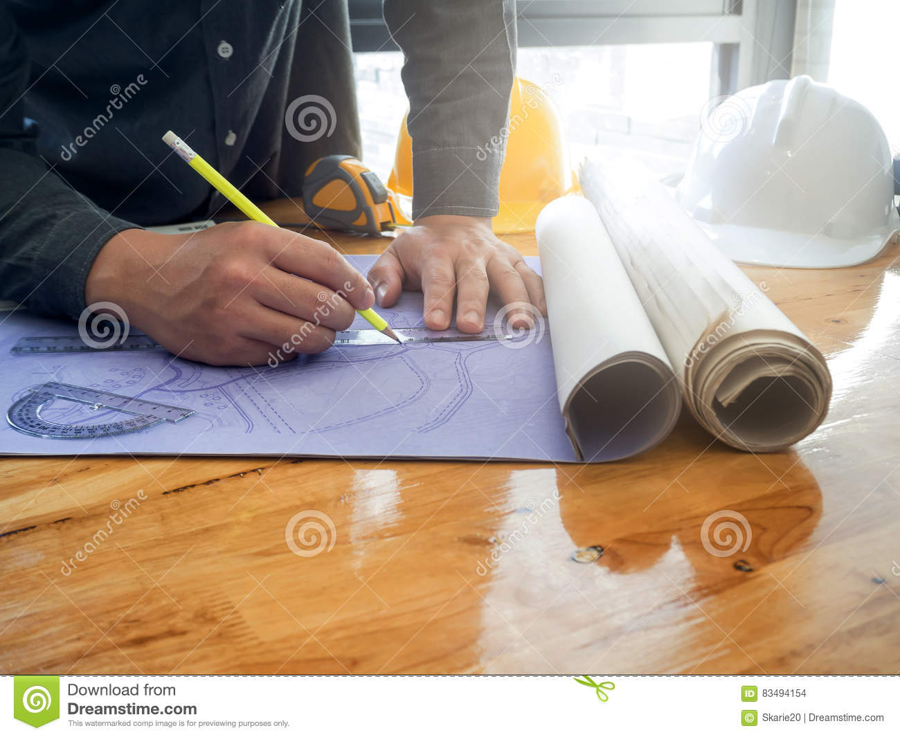 Architect sketching a construction project blueprint stock photo architect sketching a construction project blueprint malvernweather Choice Image