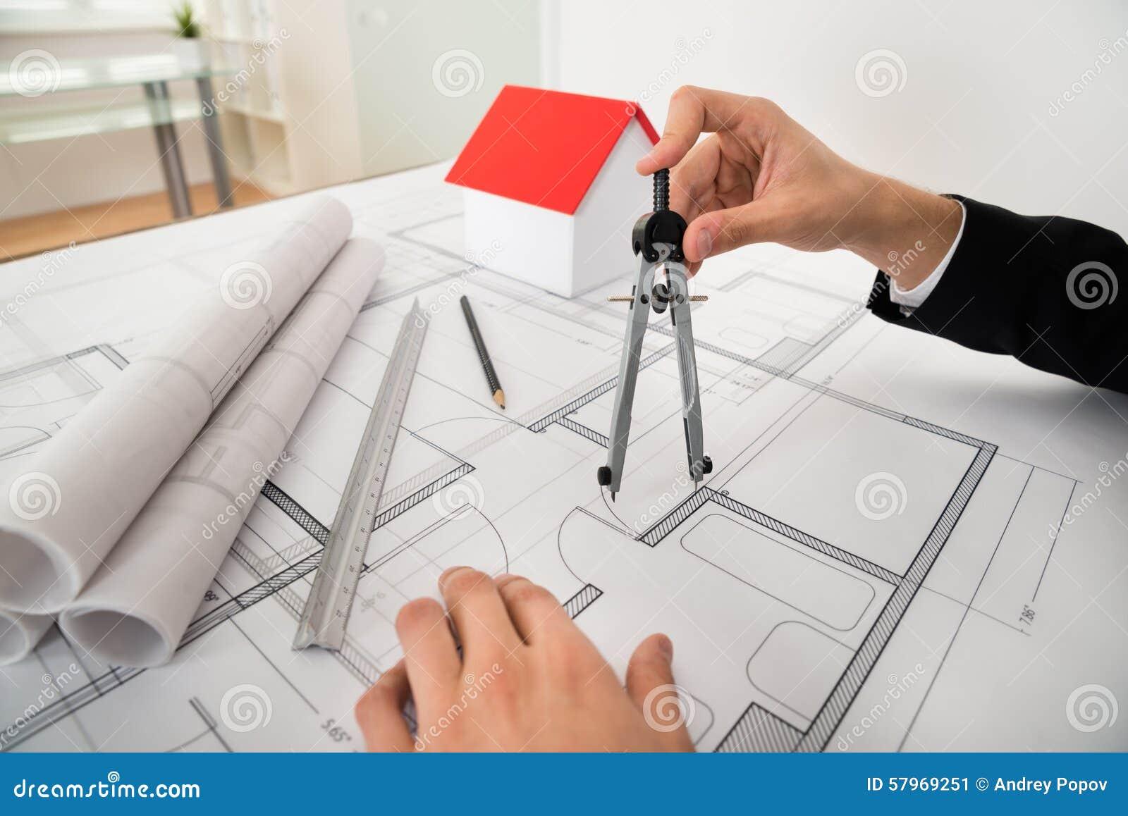 Architect using compass on blueprint stock image image of royalty free stock photo malvernweather Choice Image