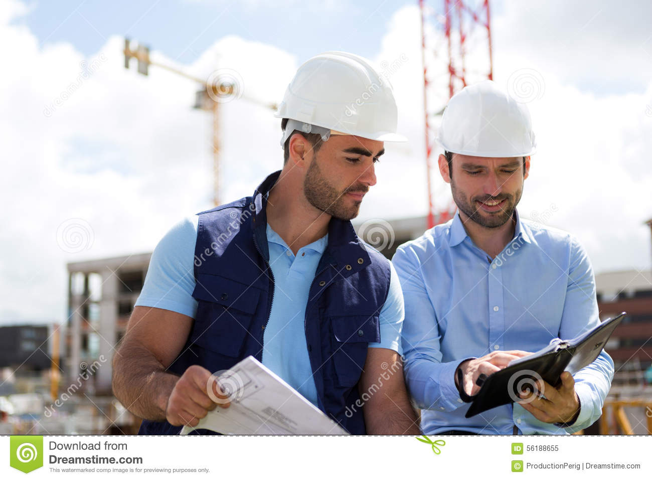 architect and worker planning meeting on construction site stock
