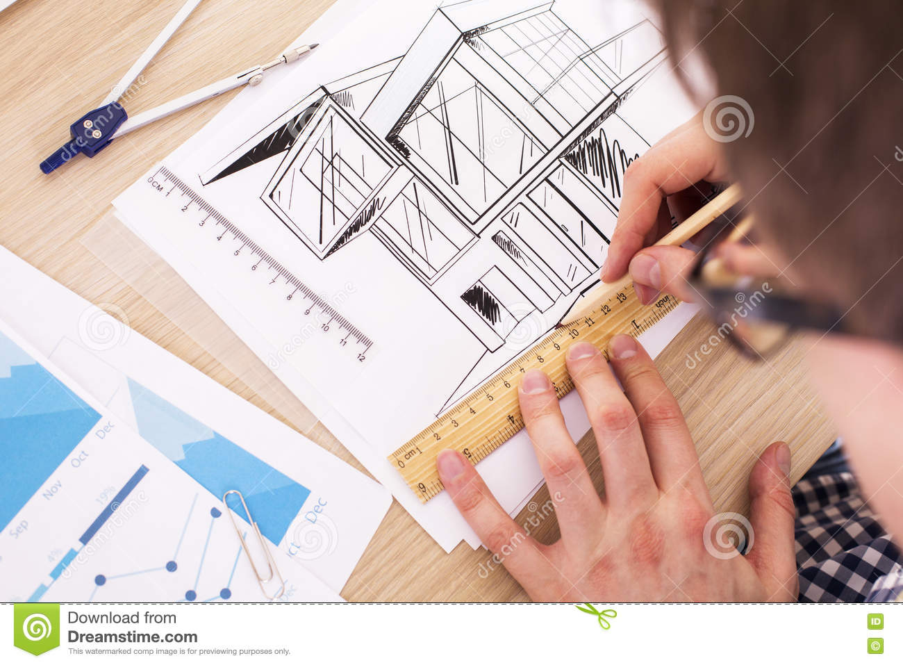 Architect Working On Blueprint