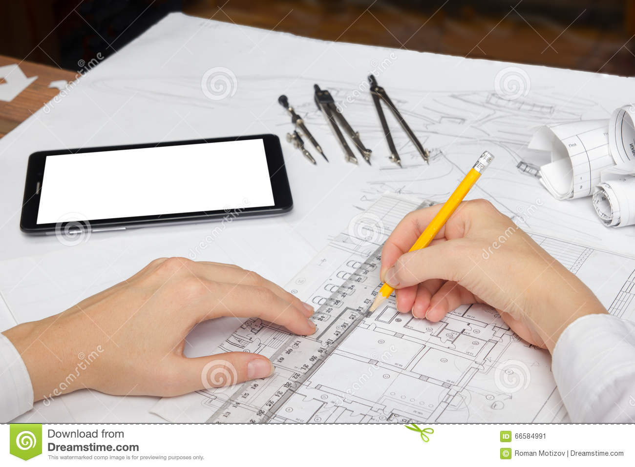 Architect Working On Blueprint  Architects Workplace - Architectural