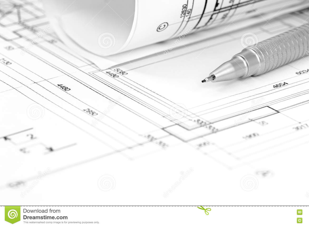 architect workspace with floor plan blueprint roll and pencil