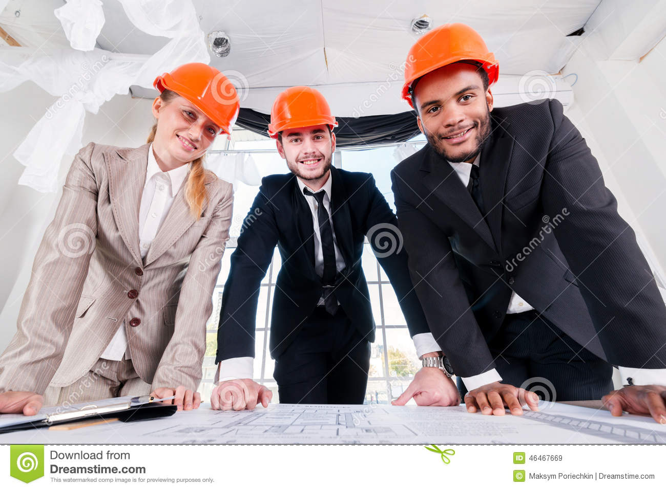 Architects of the drawings. Three businessmеn architect