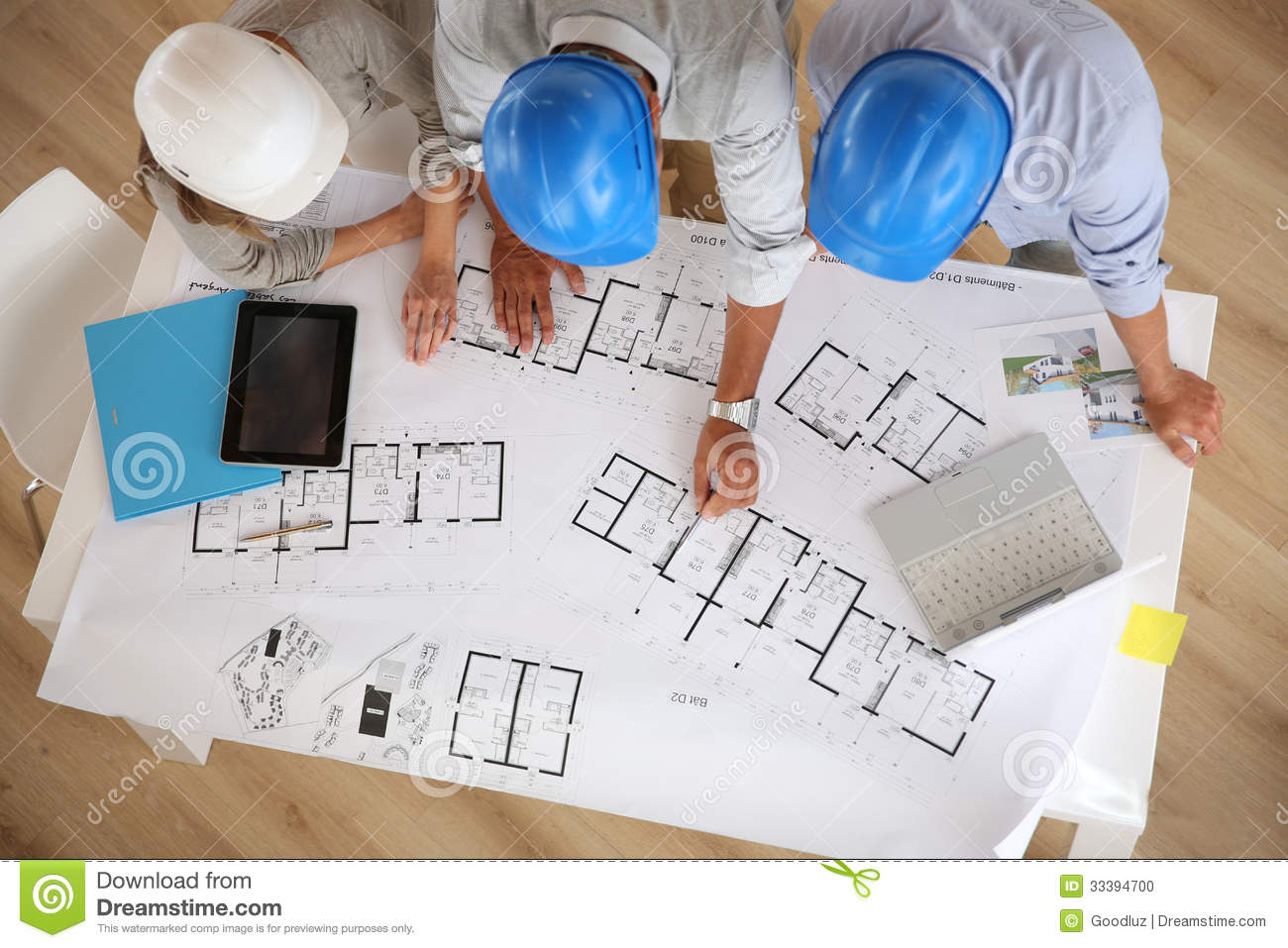 Royalty-Free Stock Photo. Download Architects With Helmets Working ...
