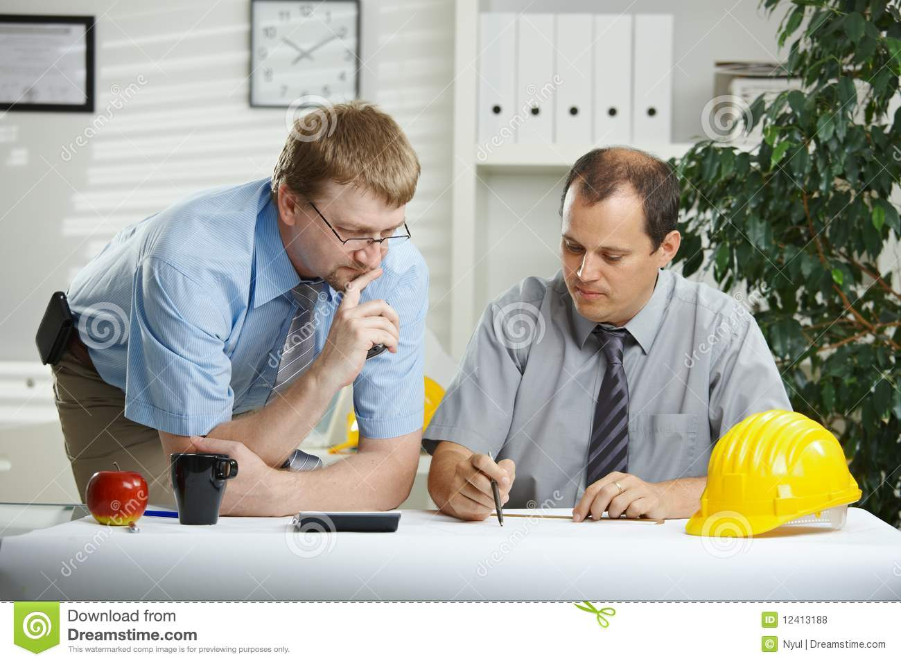 Architects talking at office