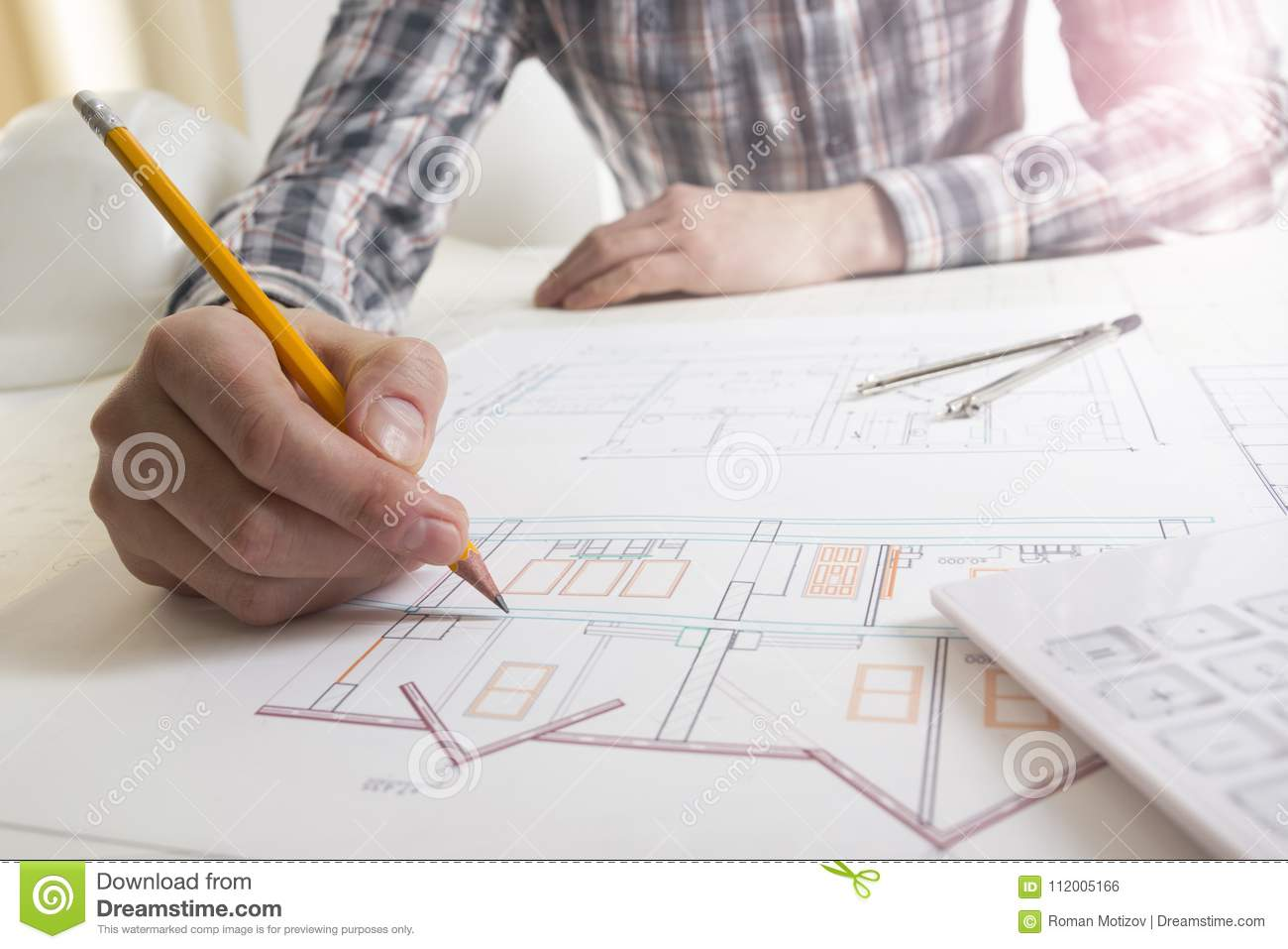 Architects working on blueprint real estate project architect download architects working on blueprint real estate project architect workplace architectural project malvernweather Images