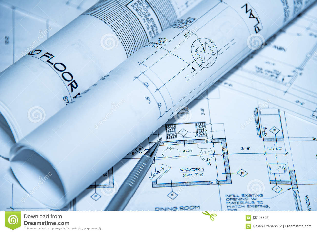 Architects workplace top view of blueprints. Architectural projects, blueprints, blueprint rolls on plans with pencil