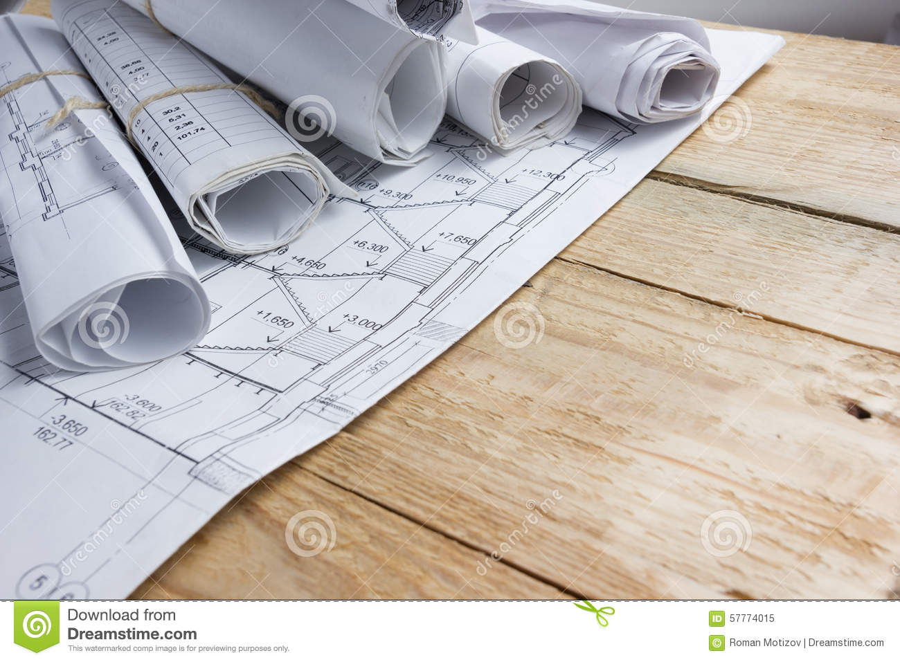 architectural engineering blueprints. Architectural Project, Blueprints, Blueprint Rolls On Vintage Wooden Background. Construction Concept. Engineering Tools Top View. Blueprints C