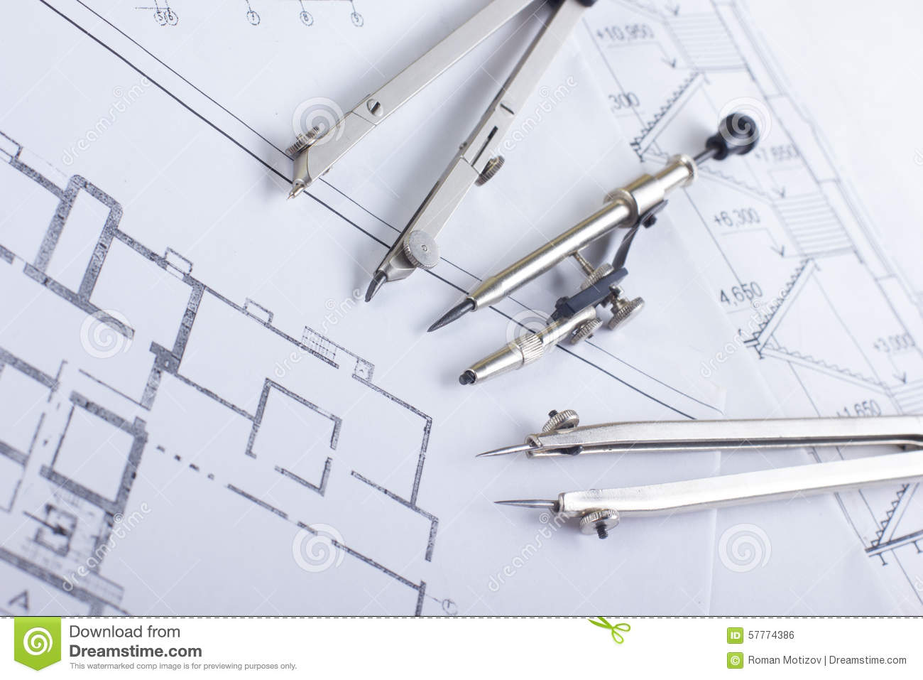 Architectural Project Blueprints And Divider Compass On
