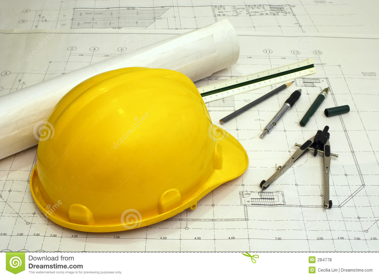 Floor plans and a hard hat with various drawing tools - scale ruler ...