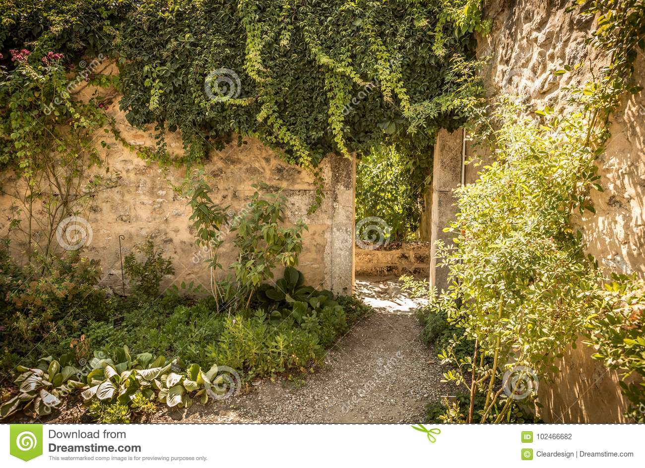 Archway Gate And Historic Stone Wall In The Garden Nook Stock Photo ...