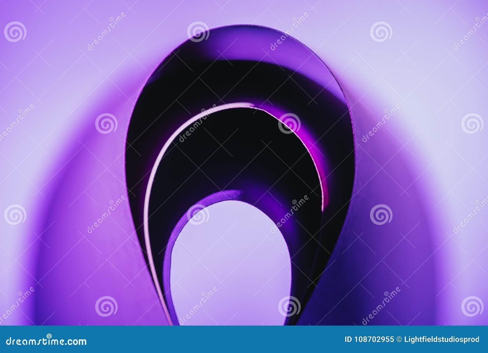 Arcs of warping purple paper