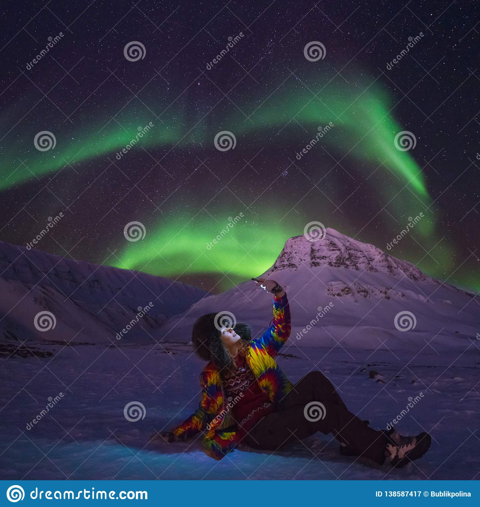 Arctic Northern lights aurora borealis sky star in Norway travel blogger girl man Svalbard in Longyearbyen city the moon mountains