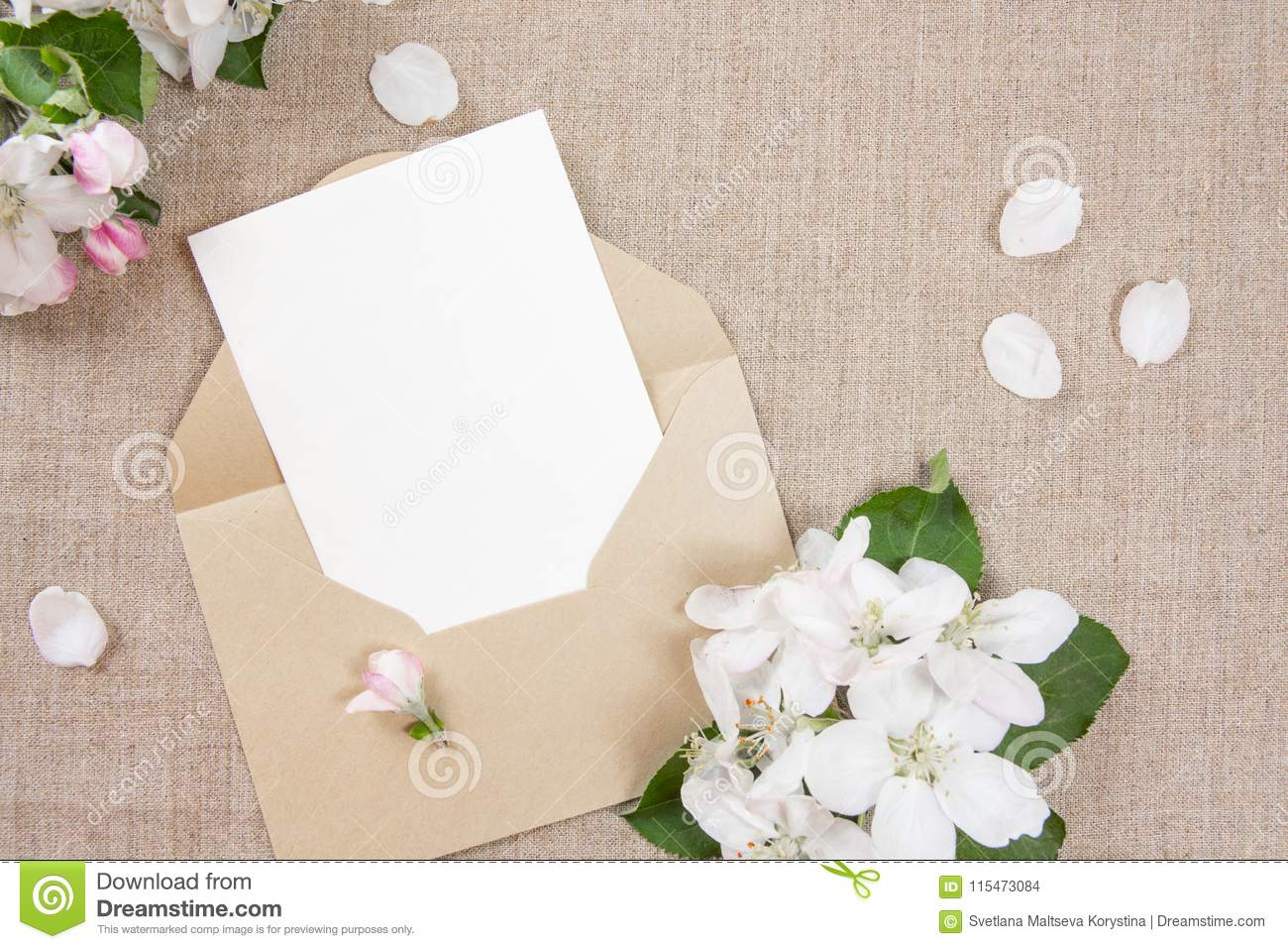 Ard With An Beige Envelope And White Flowers Of Apple Tree On Beige