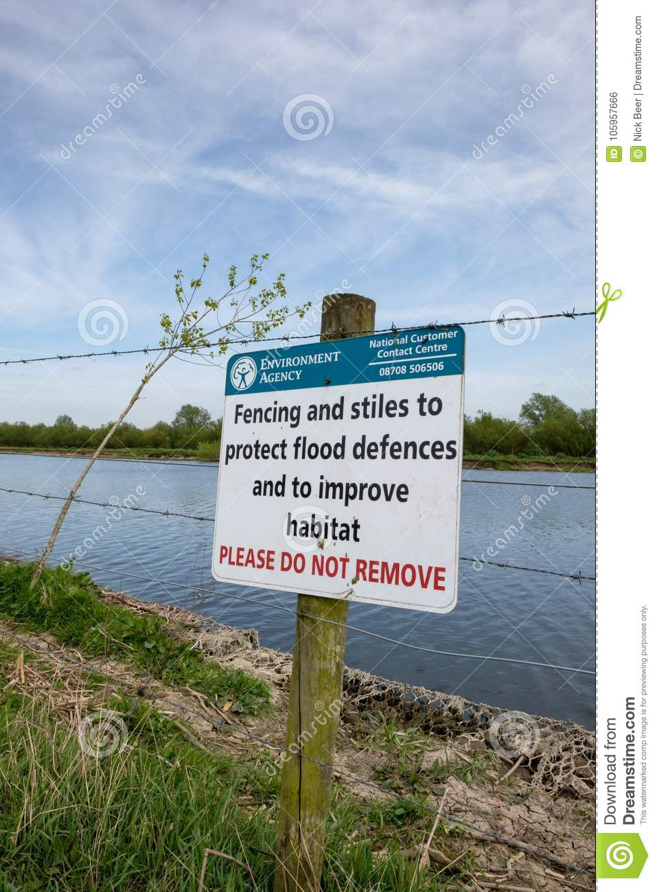 Warning Signs By The Side Of A Deep Inland River, Prone To Flooding ...