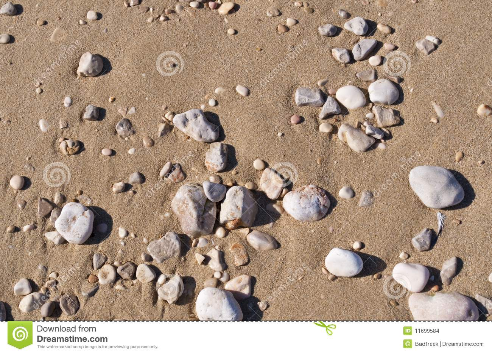 Arena de la playa fondo de las piedras imagenes de archivo for Arena de playa precio