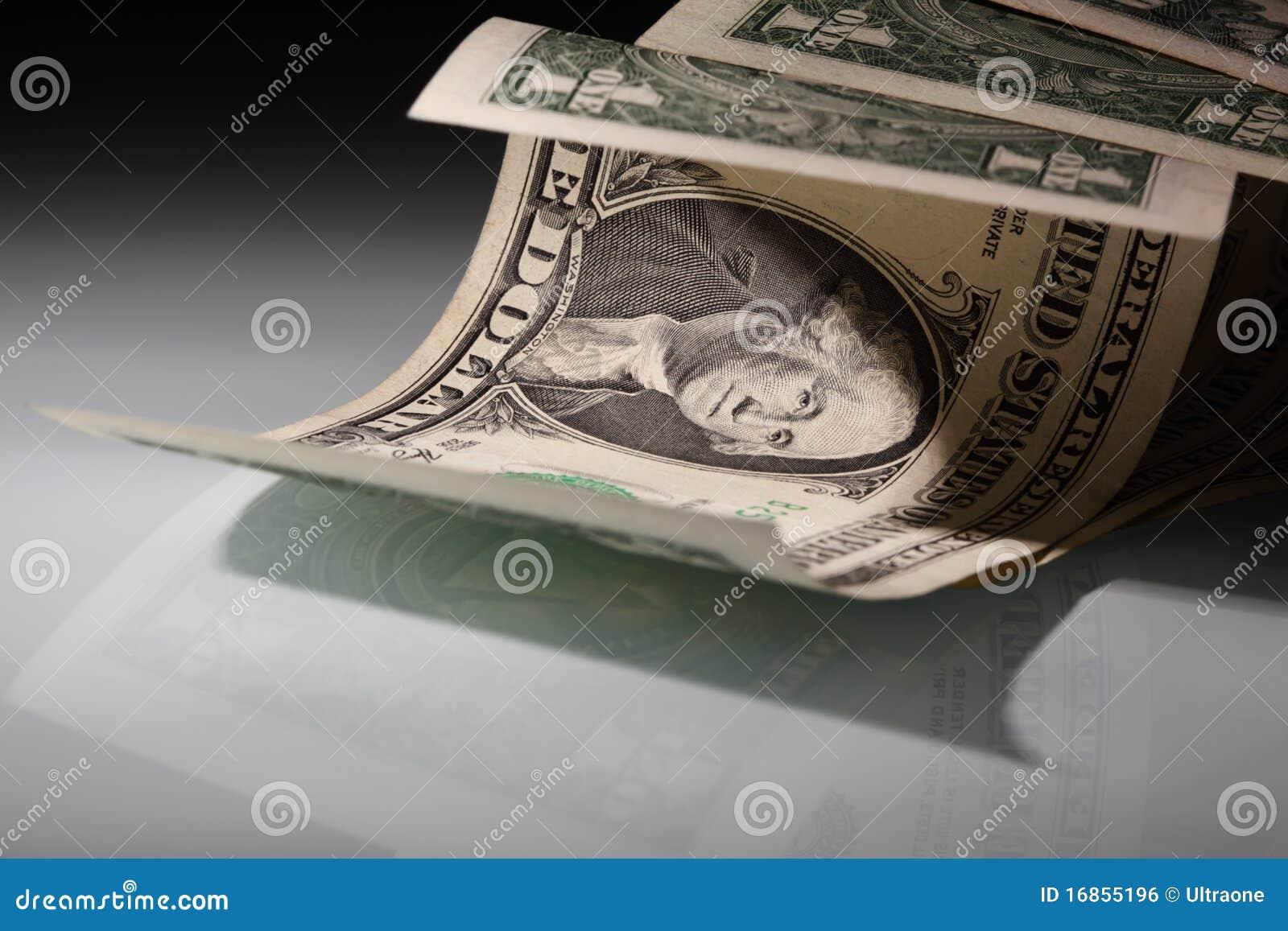 Argent. Dollars US Dans floodlit.