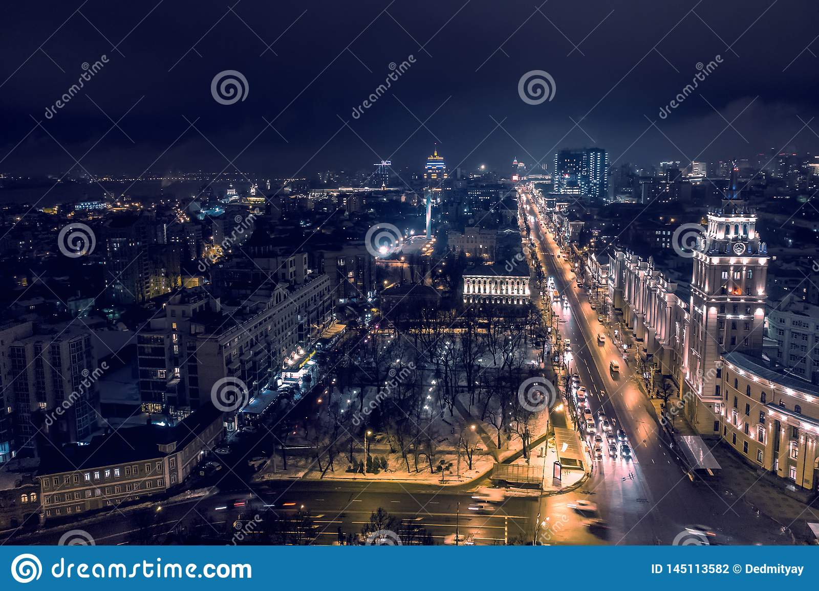 Arial view of night city Voronezh, evening cityscape with roads, parks and traffic, drone shot