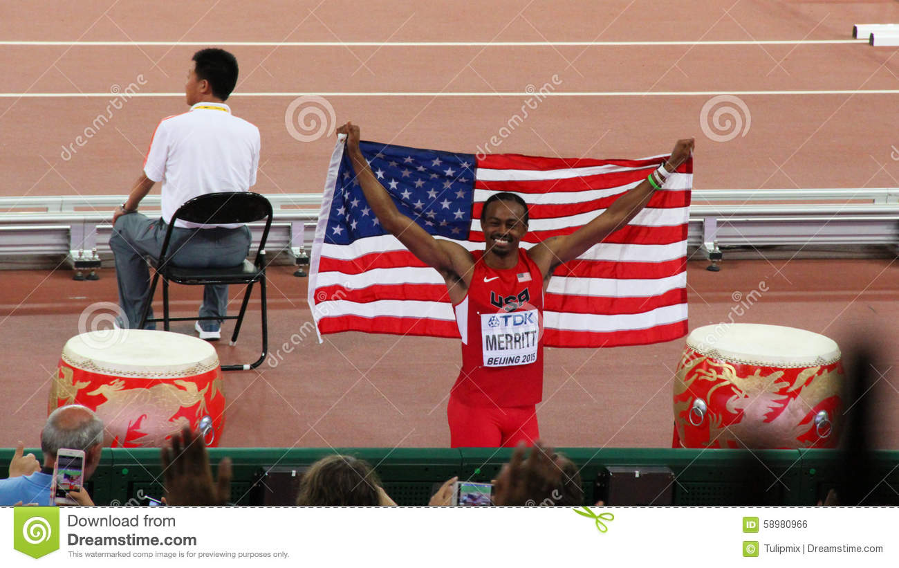 Aries Merritt of the United States showing national flag after winning bronze medal at the IAAF World Championships Beijing 2015
