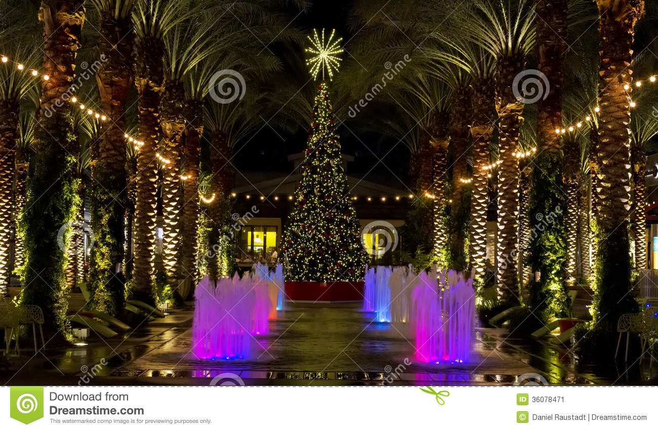 arizona shopping mall christmas tree and lighted palm trees stock