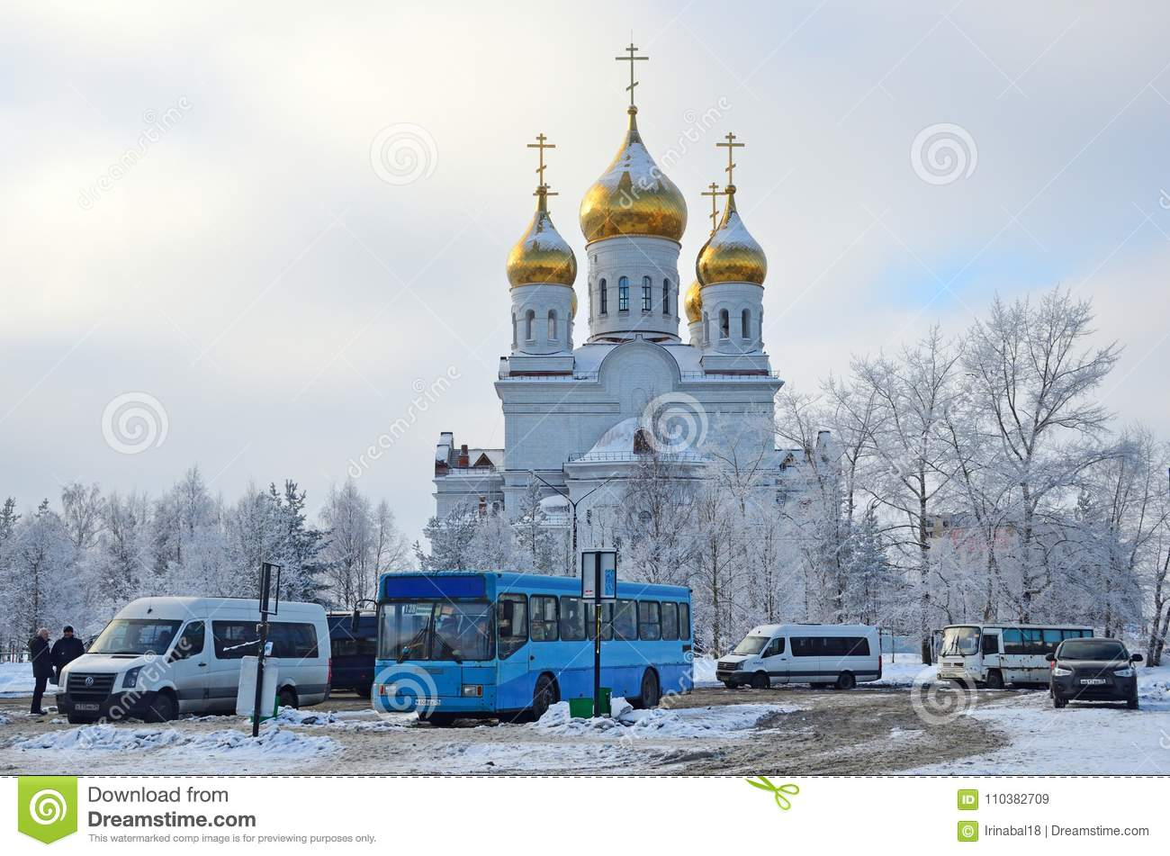 Arkhangelsk, Russia, February, 19, 2018. Public transport stop on the background of St. Michael`s Cathedral in Arkhangelsk, Russ