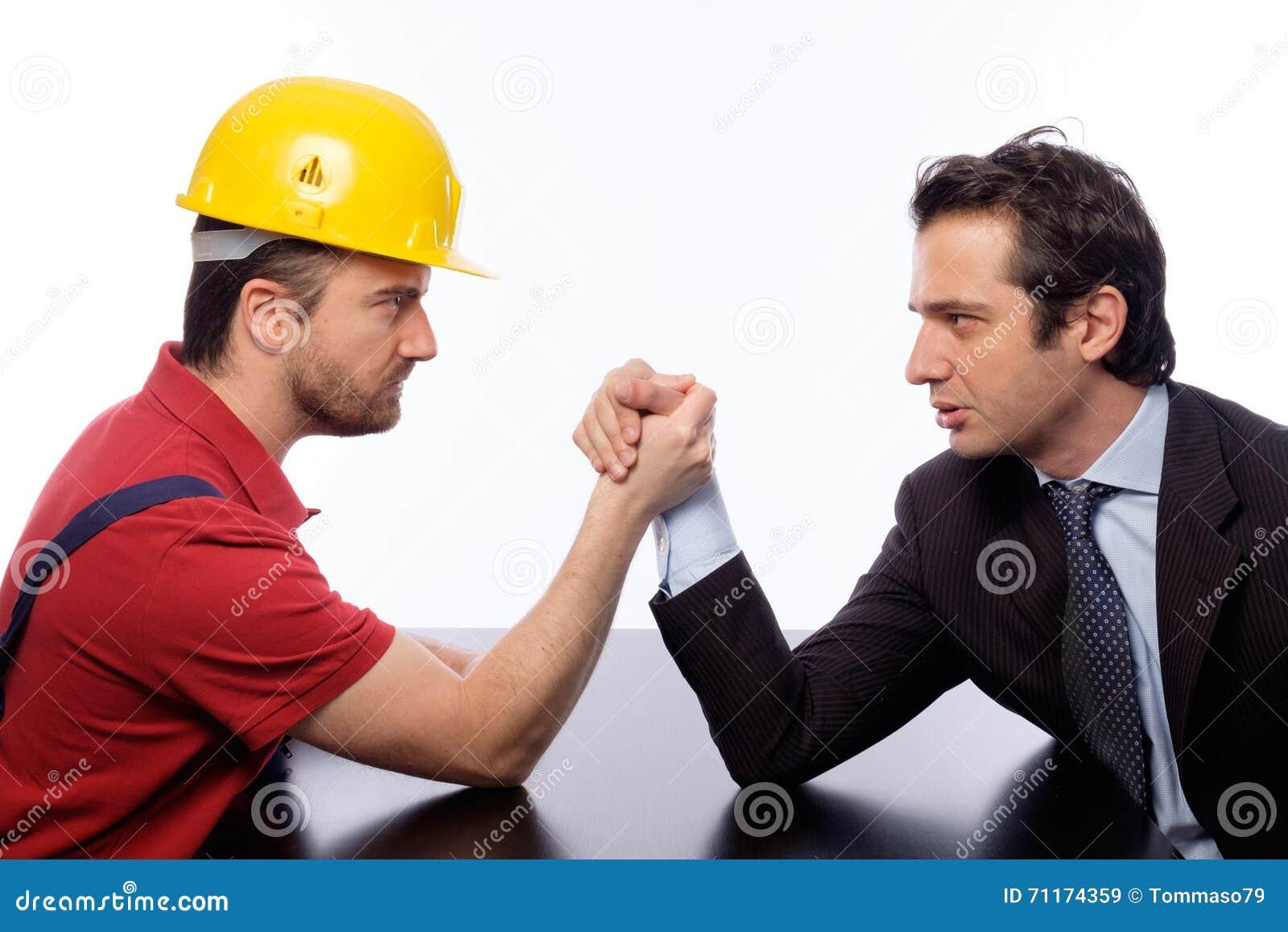 Arm wrestling white collar versus worker