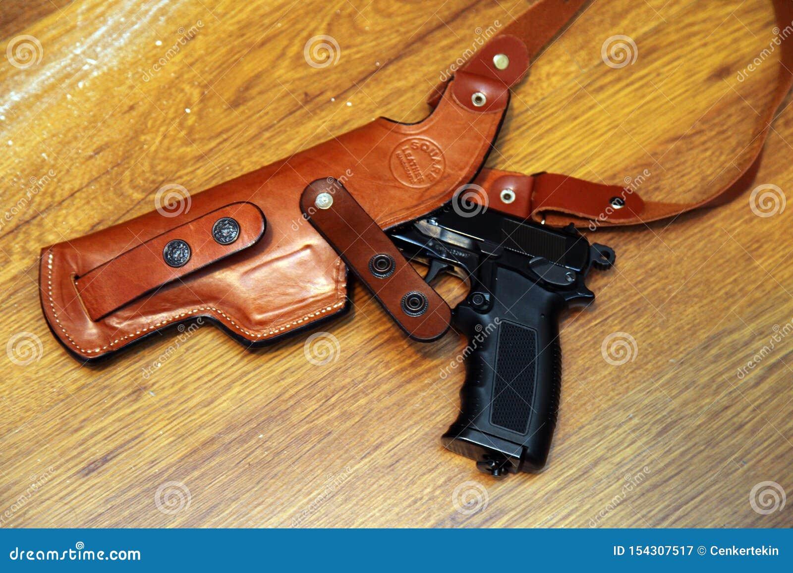 Arma e cinturão da arma